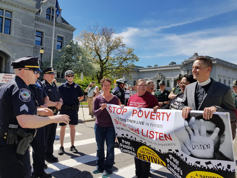Concord Police intercede as Poor People's Campaign protesters block traffic on State Street outside the New Hampshire State House.