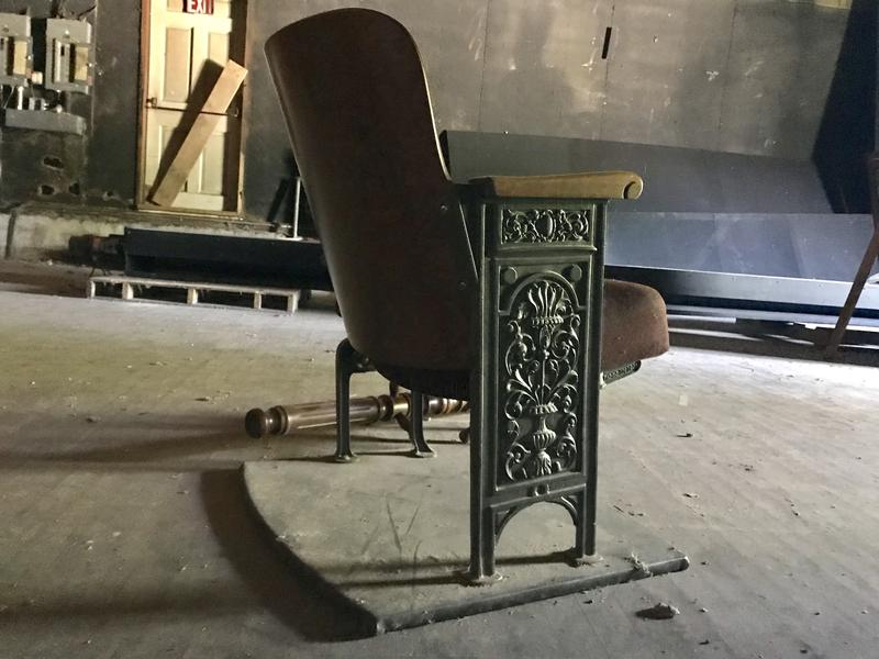 At the Majestic Theater in Conway, a single original seat sits on stage.