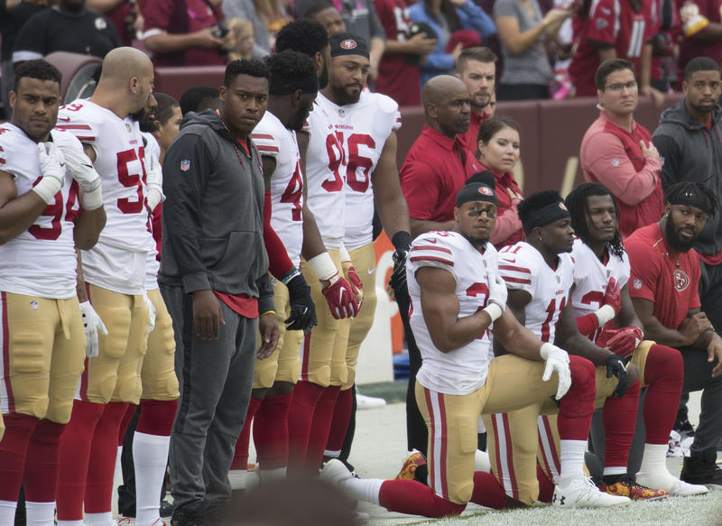 Some members of the San Francisco 49ers kneel during the National Anthem before a game on October 15, 2017