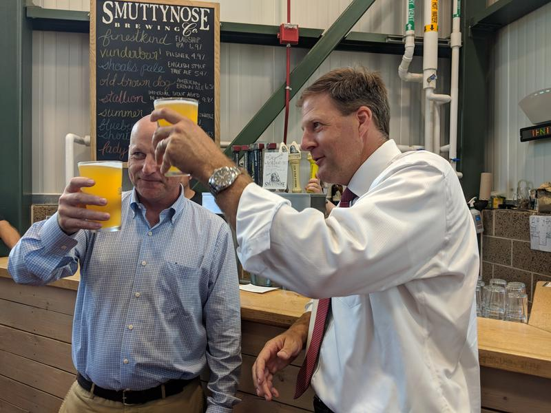 Governor Chris Sununu toasts with one of Smuttynose's new IPAs