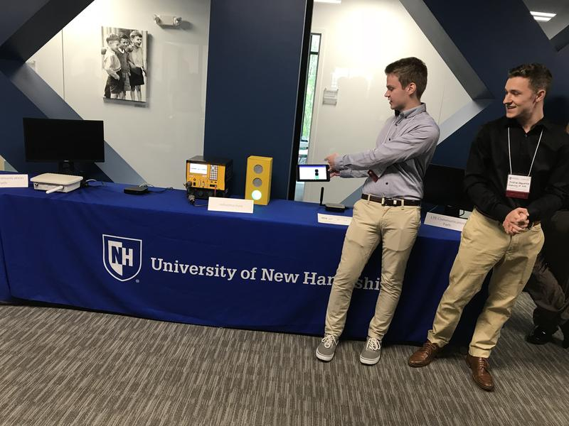 UNH computer engineering students Ethan Wamsley  and Justin Paquette provide a demonstration of vehicle-to-infrastructure connectivity tech
