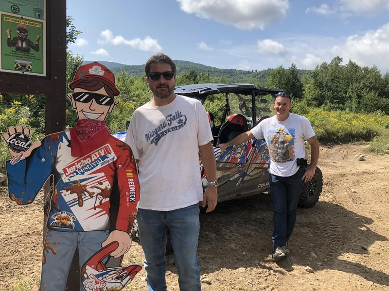NHPR's Rick Ganley, left, and Androscoggin Valley ATV Club President Steve Colite, right, at Jericho Mountain State Park in Berlin, NH