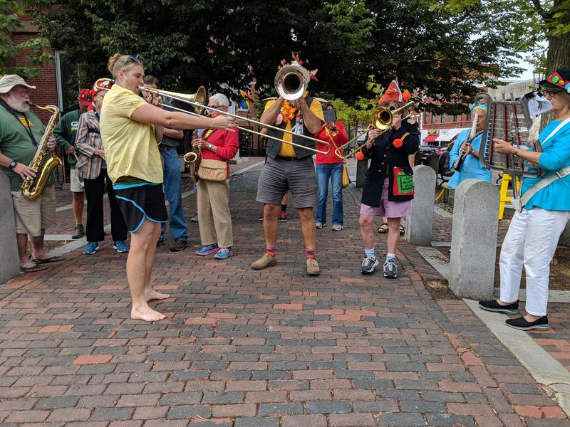 "Portsmouth's ""leftist marching band"" performs at the climate rally."