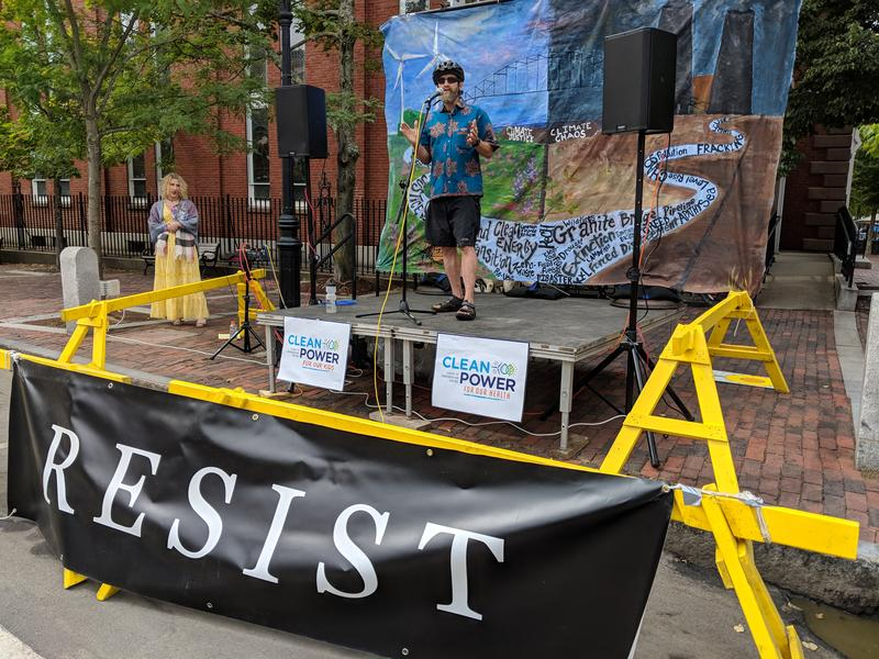 "Storyteller Andy Davis acts out a message from an optimistic future of ""climate justice"" in Portsmouth."