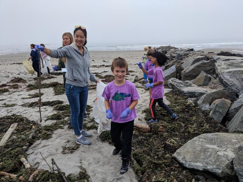 Little Harbour School second-grader Paul helps clean up Wallis Sands State Beach with his classmates and chaperones.