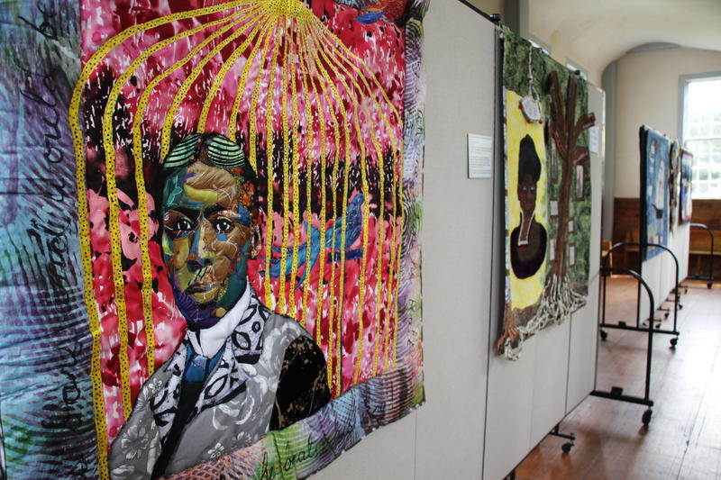 """A quilt featuring poet Paul Lawrence Dunbar on display as part of the exhibit called """"And Still We Rise."""""""