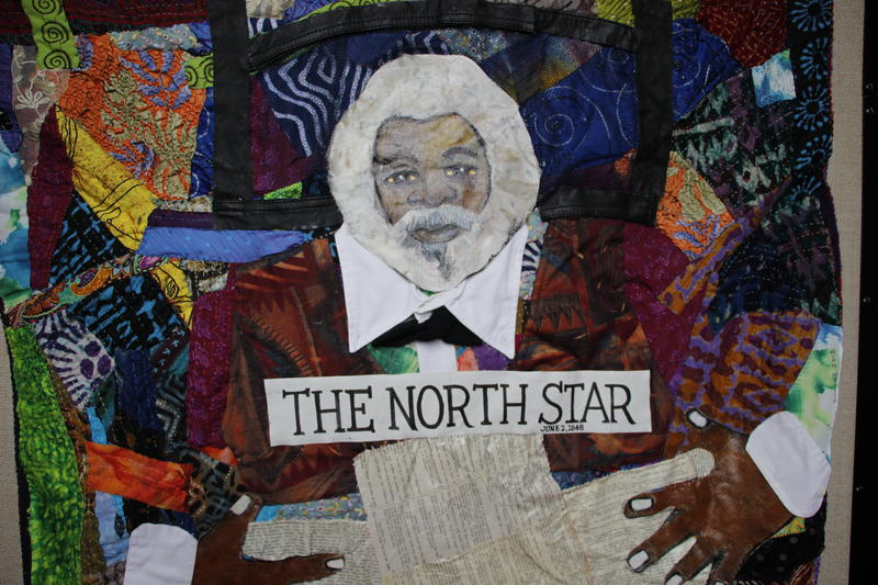 """A quilt on display as part of the exhibit called """"And Still We Rise."""""""