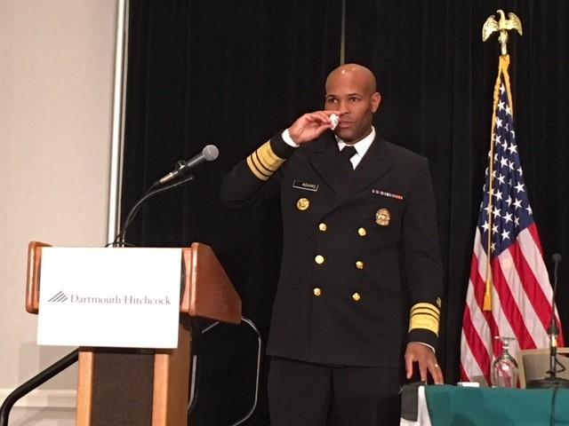 U.S. Surgeon General Jerome Adams demonstrates treating with Naloxone at a forum in Concord, N.H.