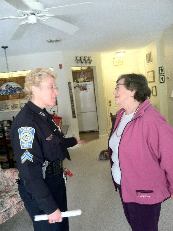 Mary Lockridge talks with Officer Jane Constant