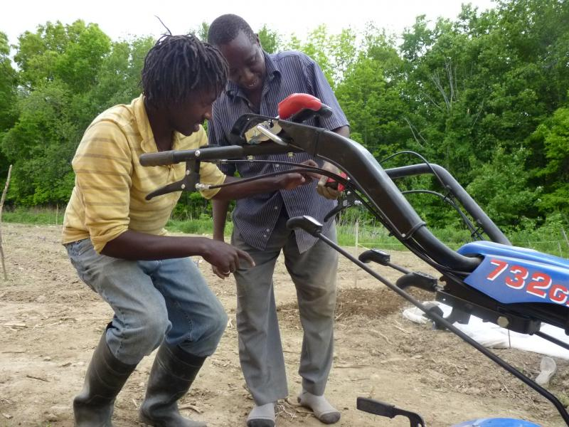 Munene training farmers on the rototiller