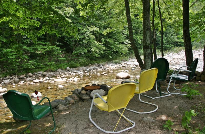 The Mount Coolidge Motel in Lincoln has chairs along the Pemi River where guests can visit in the evening.