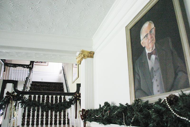 A portrait of former owner Neil Tillotson.