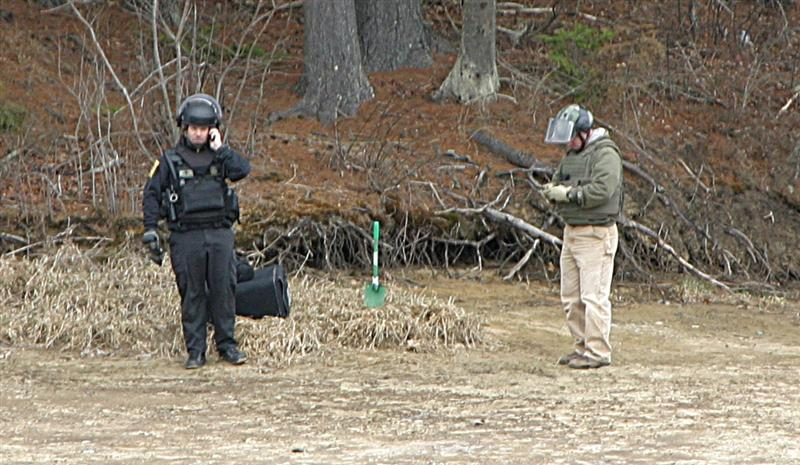 Bomb squad member Jeffrey Dade and an FBI agent buried the bomb in a secluded area and detonated it.