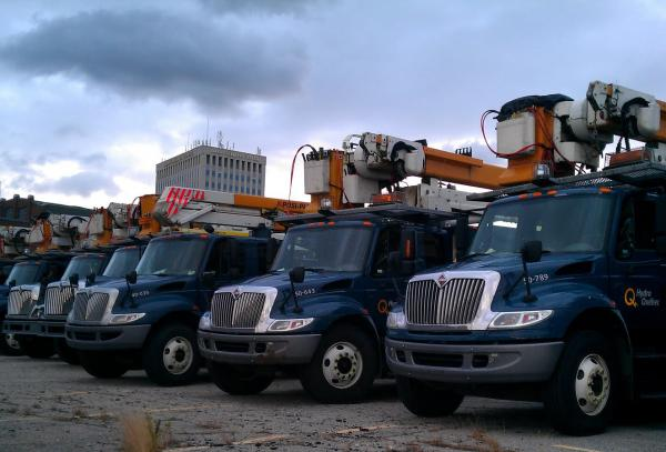 Hydro Quebec trucks line up in Manchester