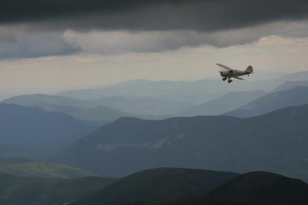 A Waco biplane over the Presidentials. Chris Jensen for NHPR