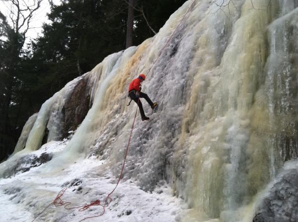 Fred Wilkinson rappels down an ice flow at Cathedral Ledge in North Conway.