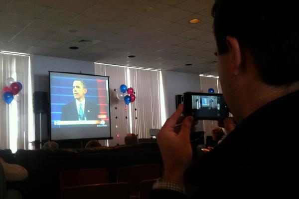 A Saint Anselm College student records President Barack Obama's inauguration on his iPhone during a watch party on the Manchester campus Monday.