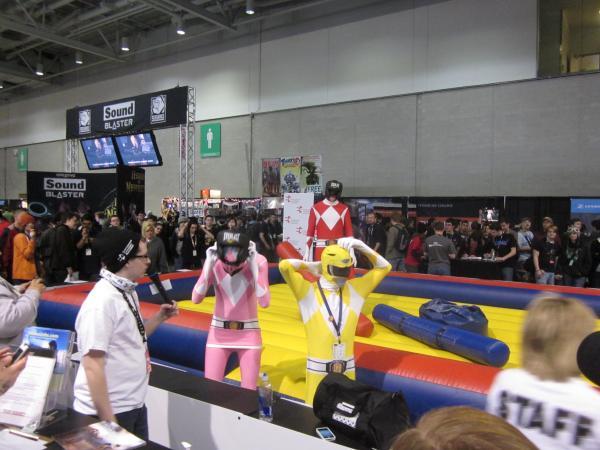 Power Rangers adjust their gear before a joust match