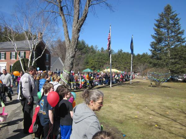 Children and parents prepare for the egg hunt