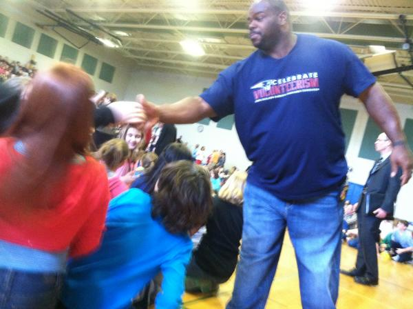 Vince Wilfork greets students at the Gilbert H. Hood Middle School in Derry.