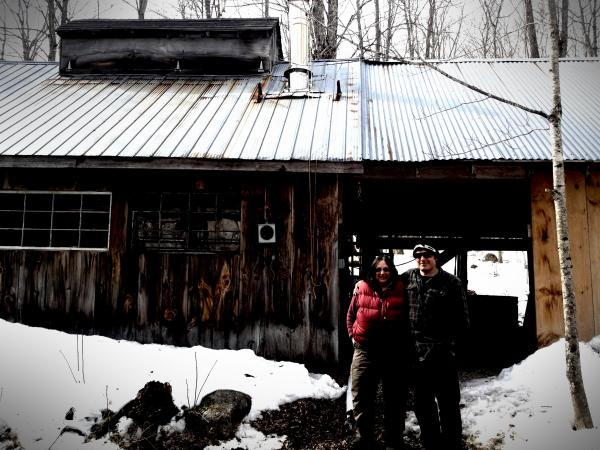 Maggie & Nate Brox in front of their sugar house.
