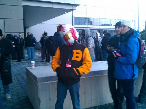 A PAX attendee posing as the main character from Hotline Miami