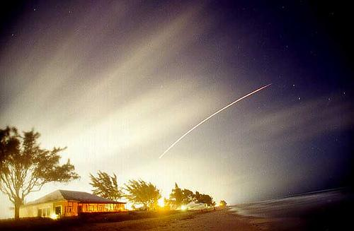 Photo of the Space Shuttle launching up the coast and over the Clubhouse on the beach at Briny Breezes.