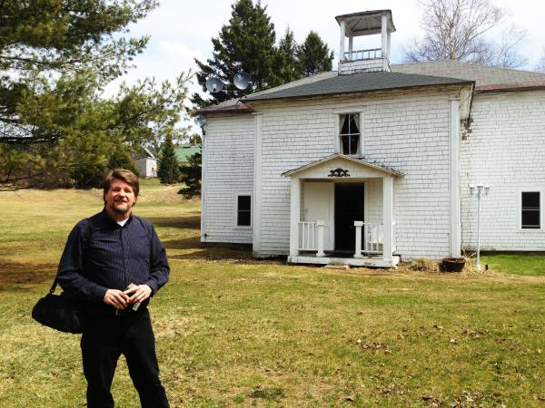 Charlie Jordan outside his home and the Colebrook Chronicle office