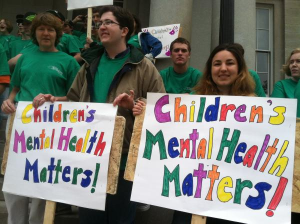 People rallied outside the State House in Concord on Thursday to recognize Children's Mental Health Awareness day.