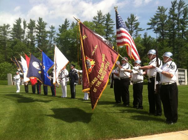 The color guard presents the flags at the Memorial Day ceremony at the New Hampshire State Veterans Cemetery on Thursday.