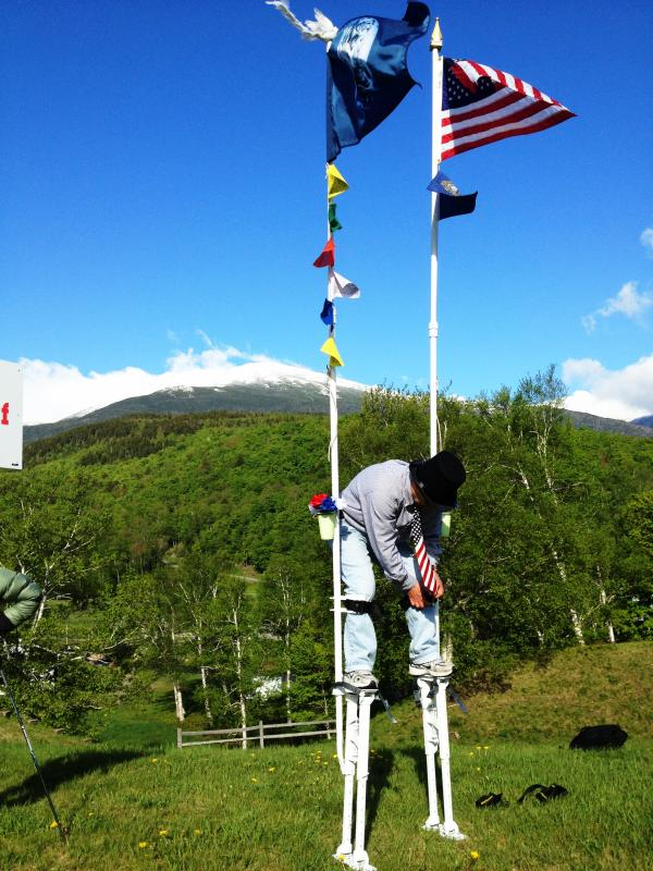 Hans Bauer straps into his stilts, preparing to ascend the Mt. Washington Auto Road for Monday's Alton Weagle Day.