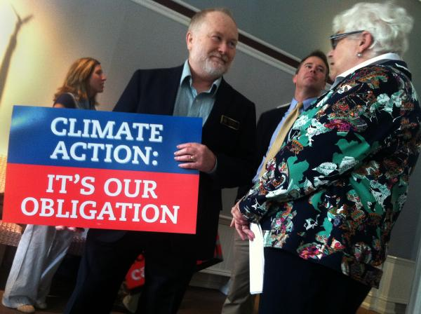 Rep. Rick Watrous and Sen. Martha Fuller Clark, both Democrats, attend an event to praise President Barack Obama's recently announced climate action plan