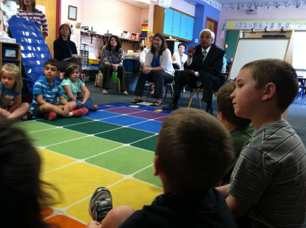 Mahesh Sharma, a math education consultant, works with a class of kindergartners in Meredith as teachers watch during a recent professional development day. Work like this is going on all over the state to get teachers ready for the Common Core