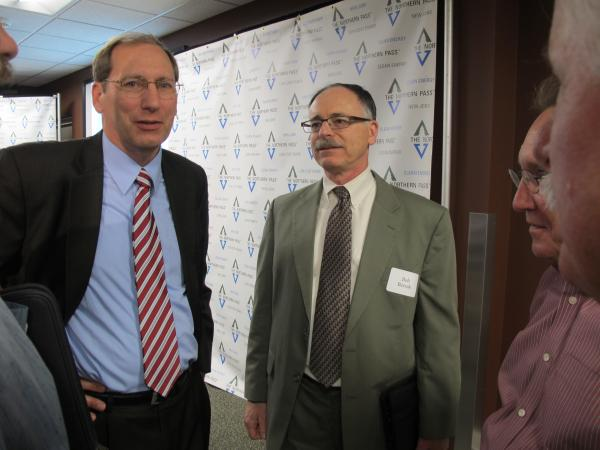 PSNH President Gary Long speaks with attendees at Thursday's Northern Pass press conference.