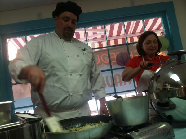 Inside Lisa's Sweets, Chef Dan St. Jean of Giorgio's Restaurant cooks up some asparagus and artichoke ravioli at this week's Taste of Milford.