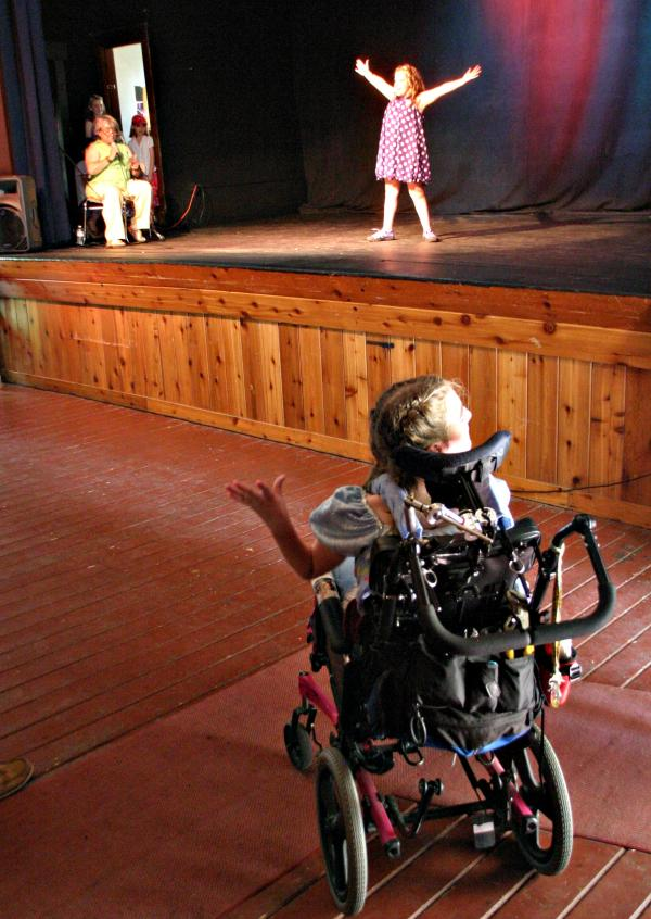 Bella Hibberd of Bethlehem, who was born with cerebral palsy, was the force behind a fashion show Sunday at the Colonial Theatre to raise money for Adaptive Sports Partners of the North Country.