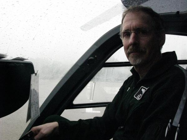 Doug Moore, one of nine pilots of Dartmouth-Hitchcock's medical helicopter, gives a tour of the cockpit while a storm rolls through.