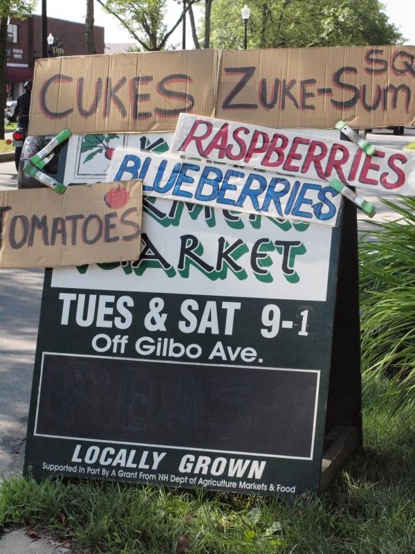 The Keene Farmers Market on Gilbo Avenue sets up Tuesdays and Saturdays 9 a.m. to 2 p.m. A busy sign touts some of its offerings.