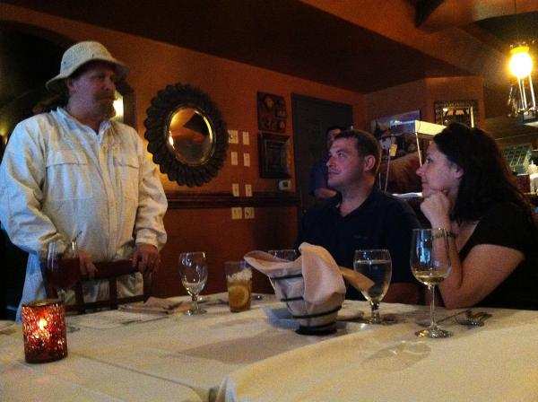 Nashua beekeeper Kagen Weeks chats with Joey and Janis Paradise of Amherst at the Farmers Dinner.