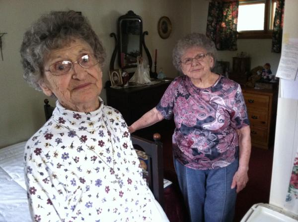 Sisters Lorraine Fitzgerald, left, and Rachel Petchell, in their Manchester home. They were burglarized on July 17 by a man posing as a handyman there to work on their lawn.