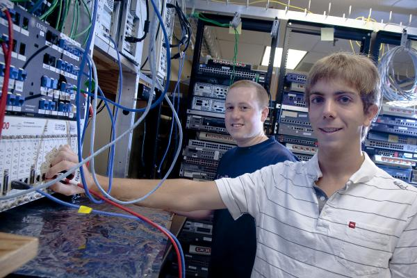 UNH Alumns Dave Andrews and Ben Major at the InterOperability Lab