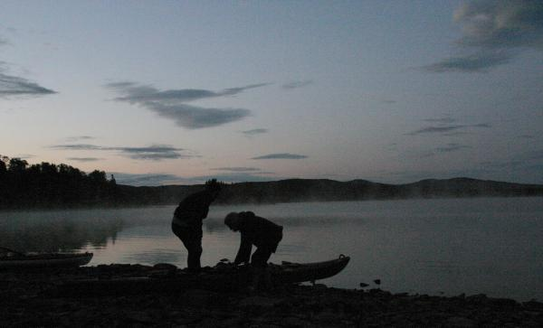 Kayakers prepare for a dawn patrol on the First Connecticut Lake. Photo by Chris Jensen for NHPR.