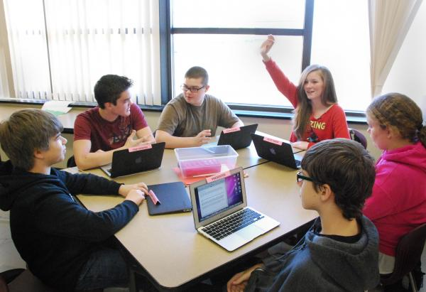 8th grade language arts students in Mooresville, NC work with laptops; the computers give them personalized assignments to improve the skills that they need to work on.