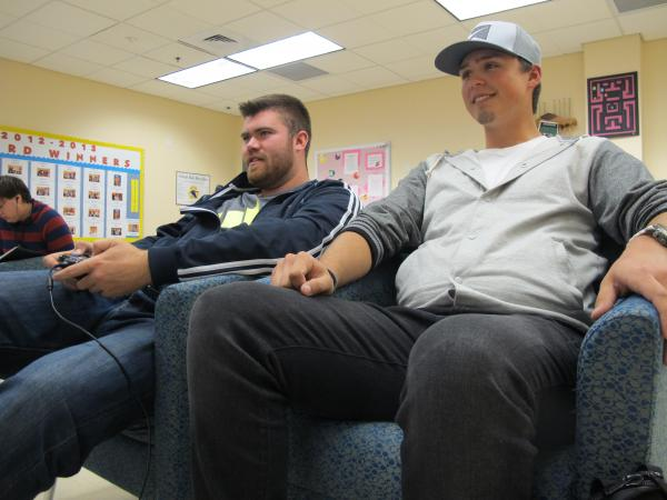 Zach Aumand sits with his friend Ryan Leavitt at Great Bay Community College's current Student Center.
