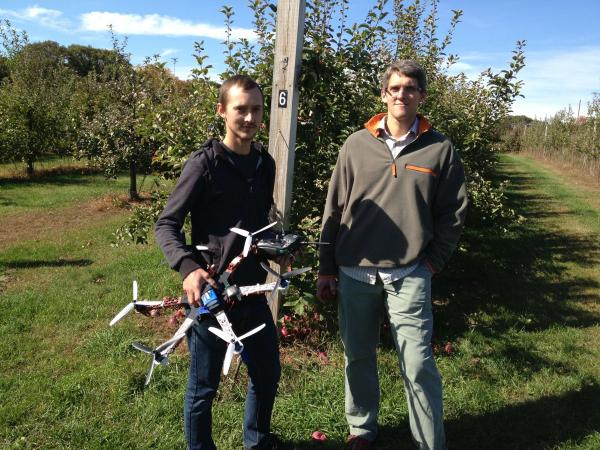 UNH doctoral student Matt Wallhead (left) and assistant professor of plant pathology Kirk Broders, with their unmanned aerial vehicle.
