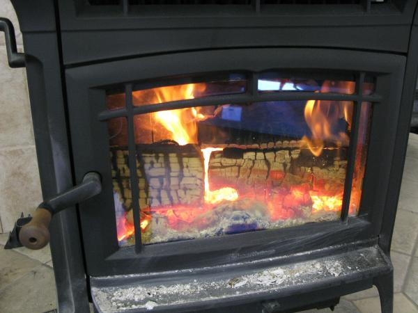 EPA certified wood stoves today have to emit fewer than 7 grams of particulate per hour, like this one, already are below 2.