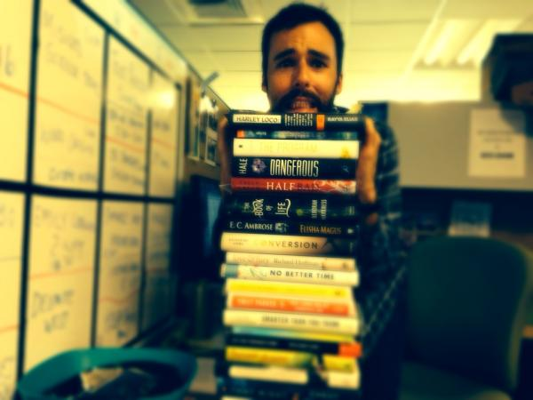 The terror of an unfinished pile of books re-created by Producer Zach Nugent.