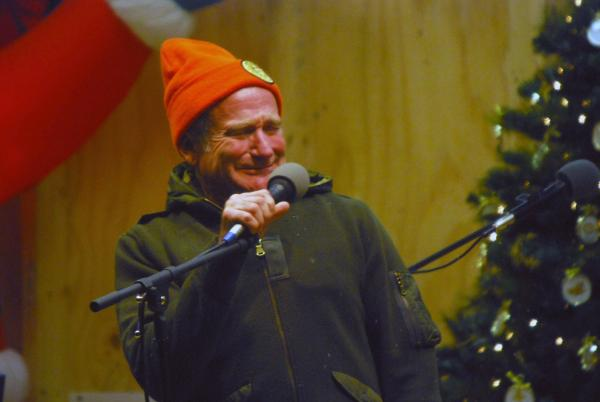Comedian Robin Williams performs for military men and women as part of a United Service Organization (USO) show on board Camp Phoenix.