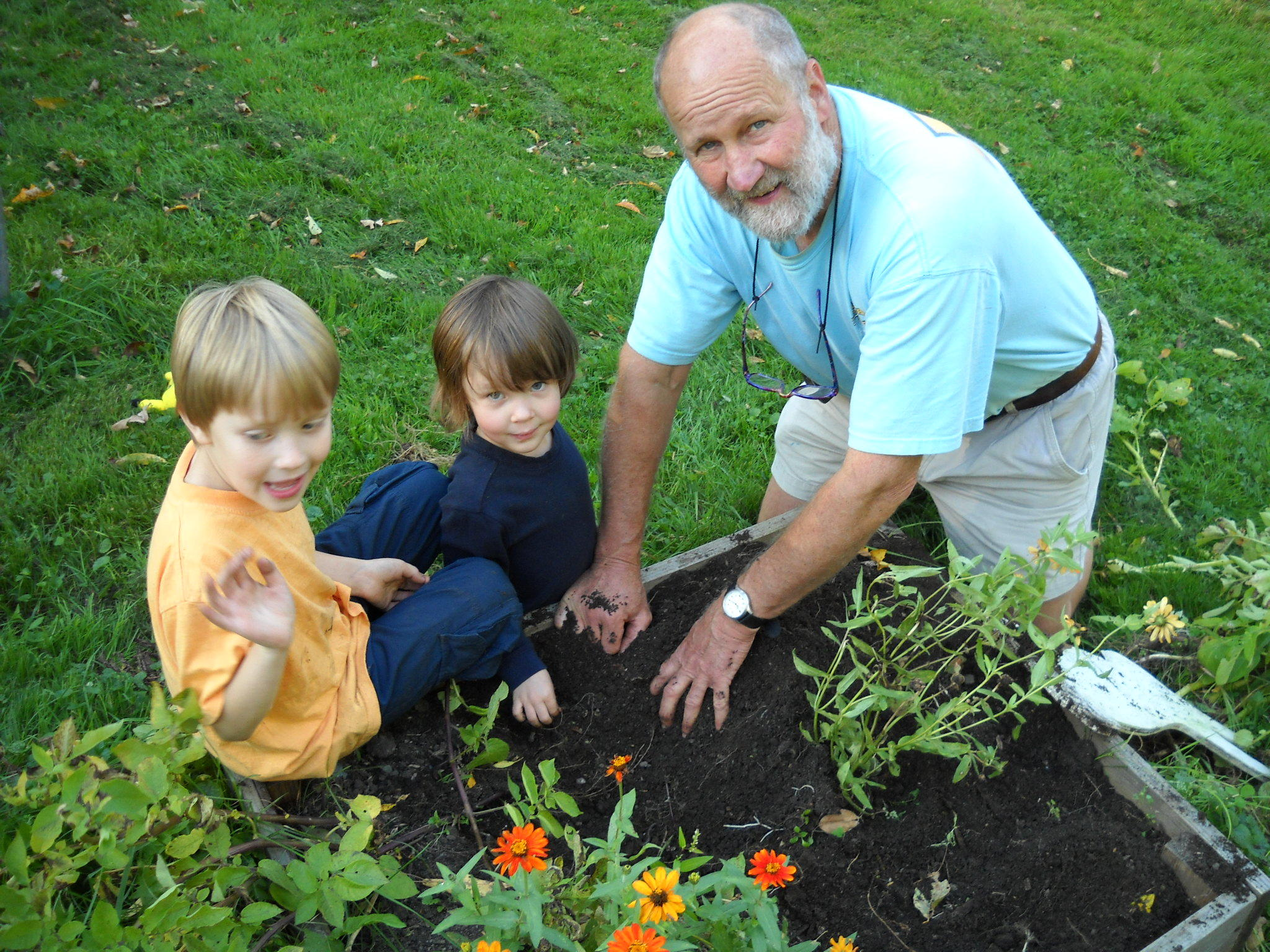Charming Henry Gardening With His Grandsons