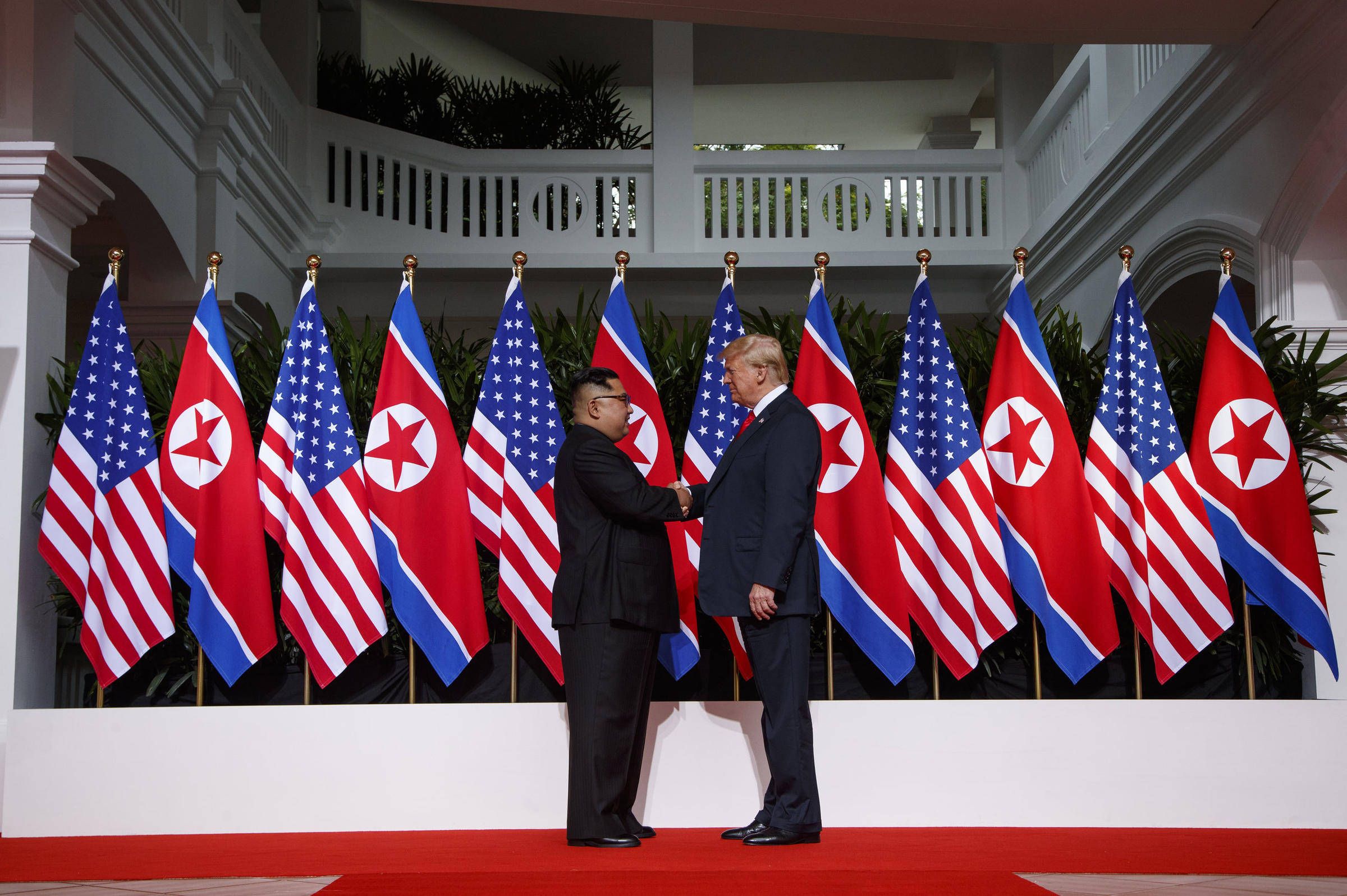 President Donald Trump shakes hands with North Korea's Kim Jung Un during their summit in Singapore